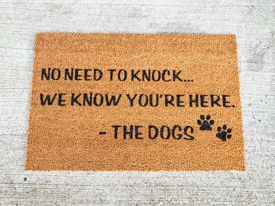 Amazing no need to knock we know you're here the dogs welcome doormat